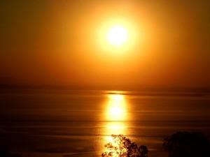 El aura, baño sol